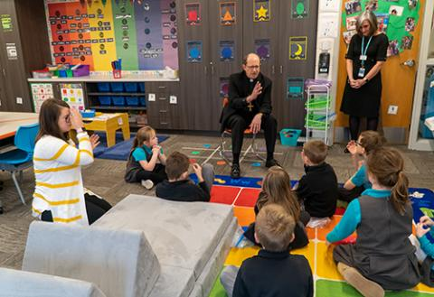 Bishop Blesses St. Robert Students