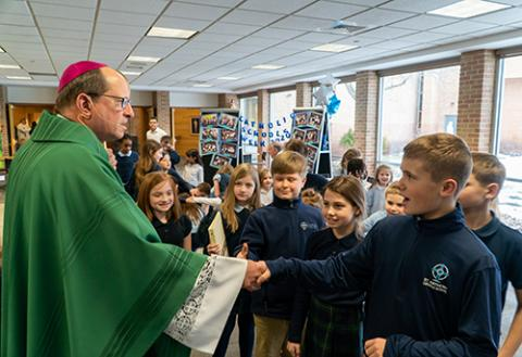 Bishop Walkowiak with students