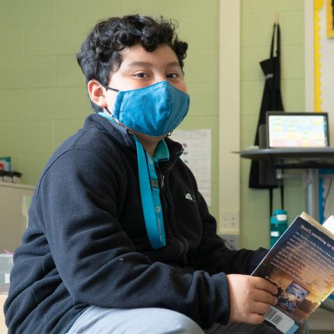 A student reads at St. Robert Catholic School.